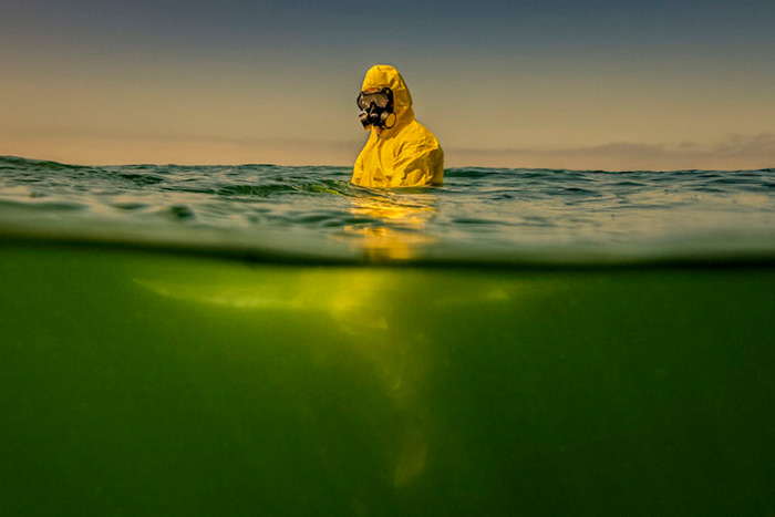 HAZMAT-SURFING-PHOTOS-PREDICT-A-POISONOUS-DARK-FUTURE-FOR-OUR-OCEANS-810x540